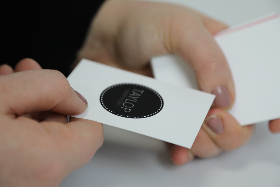 matt lamination business card with a white background and black logo