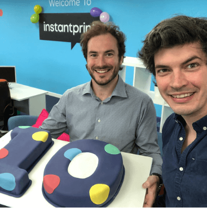 instantprint founders Adam and James with their 10th birthday cake