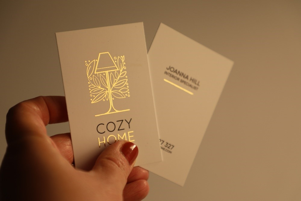 Gold foiling logo on a white business card