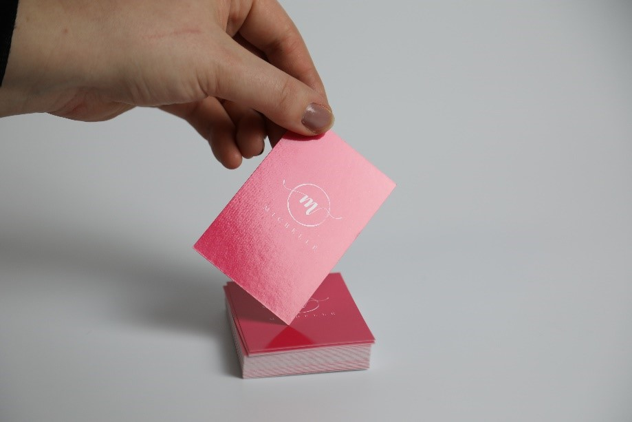 pink business cards with a gloss lamination finish