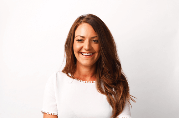 Founder of dairy and nut free dessert company Kirsty Henshaw in a white shirt
