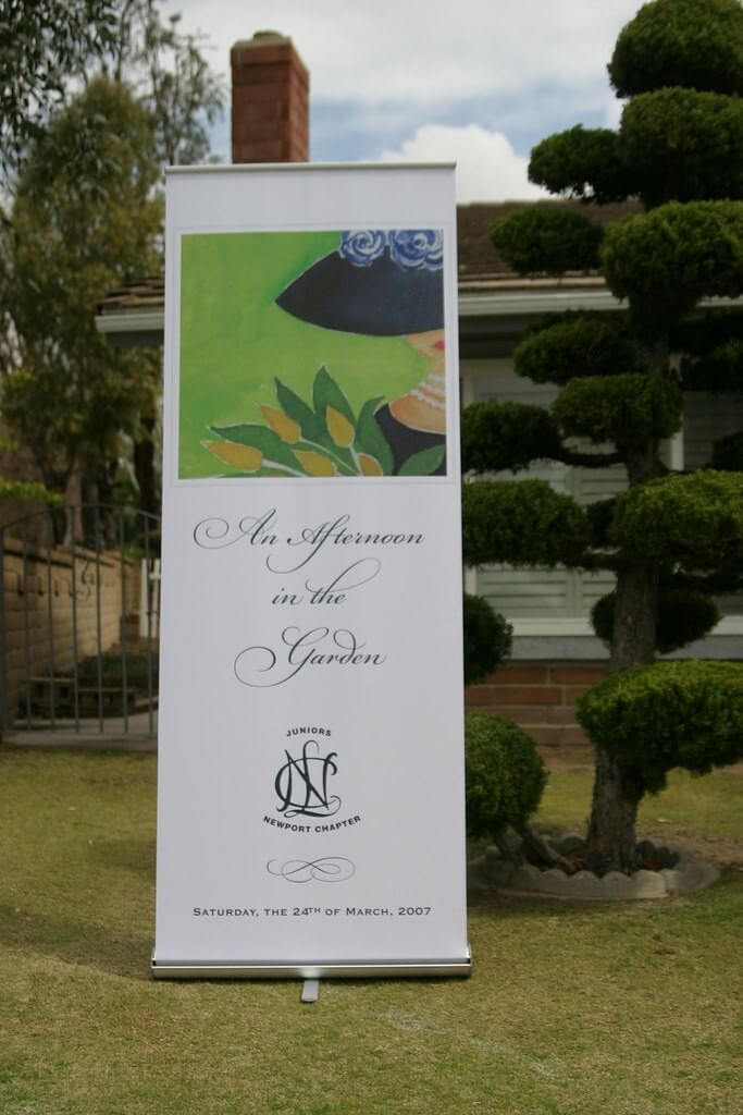 garden party roller banner advertising an outdoor event