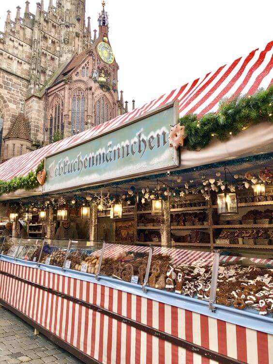 christmas market stand selling german treats