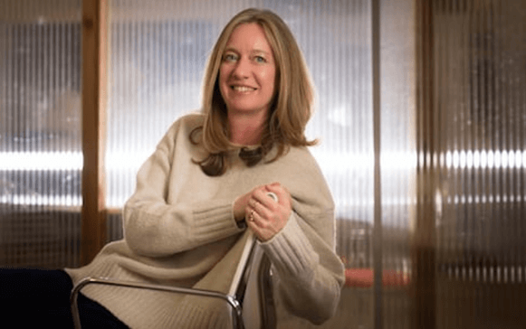 Founder of online forum mumsnet Justine Roberts sat sideways on a chair smiling