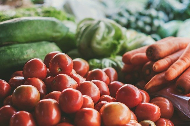 a selection of fresh fruit and vegetables in green and red colours