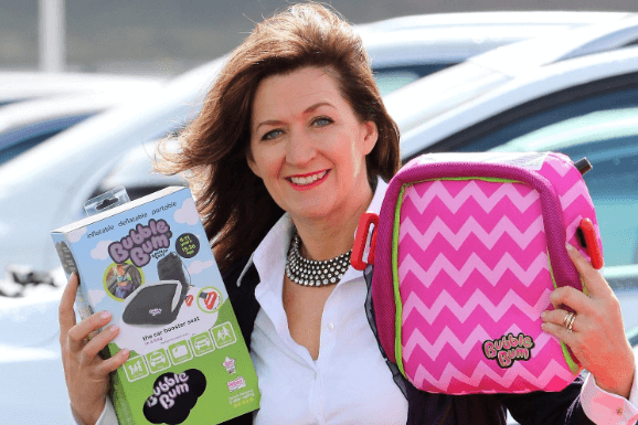 CEO and inventer of bubble bum children's car seats Grainne Kelly holding her invention for a pitcure