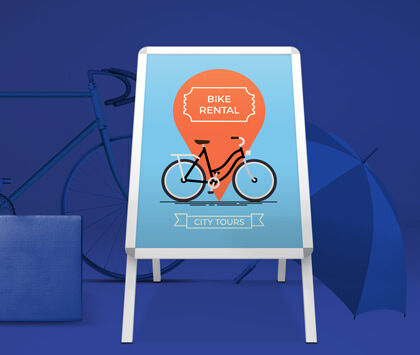 A silver a frame advertising a bike rental service on a blue background