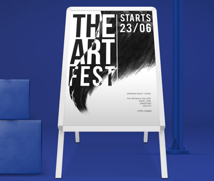 A silver a frame on a dark blue background with a black and white advert for an art festival
