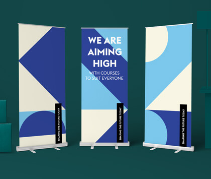 A dark green image containing three printed blue educational roller banners.