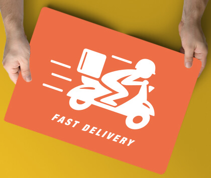 An orange promotional fast food delivery magnetic sign held in hand.