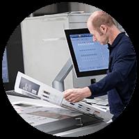 Print technician inspecting print